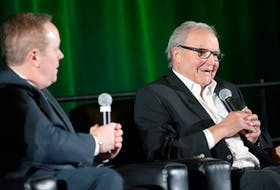 Billy MacMillan, right, tells a story during his induction ceremony into the UPEI Sports Hall of Fame in 2017. Also inducted that night were Vince Mulligan and Jack Kane Jr.