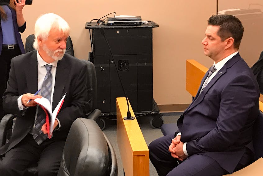 RNC Const. Steve Curnew (right) speaks with his lawyer, Randy Piercey, in provincial court Friday morning in St. John's.
