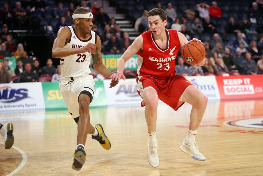 Memorial's Cole Long (right) led all players in scoring Friday in an AUS men's basketball quarter-final against the Saint Mary's Huskies, but it wasn't enough to help the Sea-Hawks to a win.