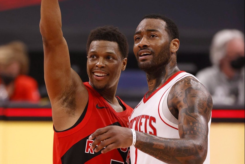 Toronto Raptors guard Kyle Lowry and Houston Rockets guard John Wall talk after Friday's game.