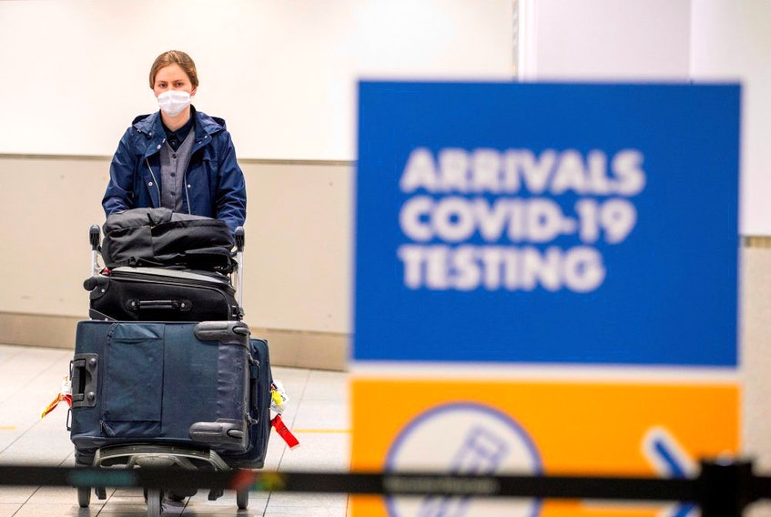A passenger arrives at Toronto's Pearson airport after mandatory COVID-19 testing took effect for international arrivals in Mississauga, Ontario, February 1, 2021.