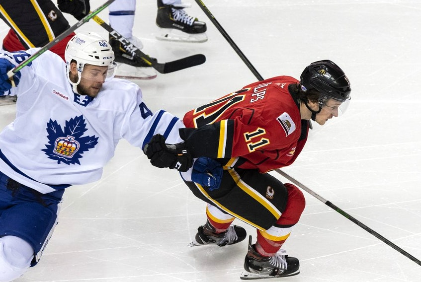 Stockton Heat sniper Matthew Phillips leaves the Toronto Marlies' Calle Rosen behind during a game at Scotiabank Saddledome this past Sunday.