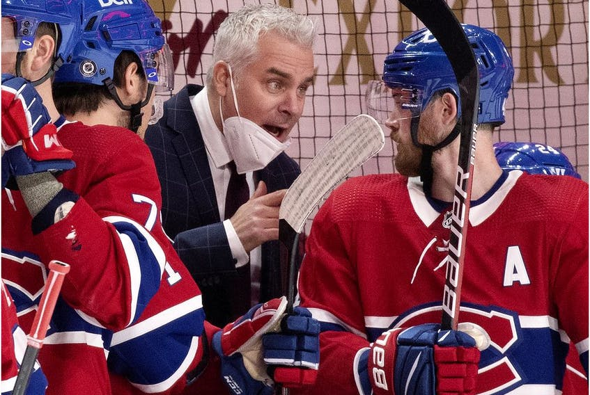 Montreal Canadiens interim head coach Dominique Ducharme speaks to left-winger Paul Byron during game against the Ottawa Senators in Montreal on March 2, 2021.