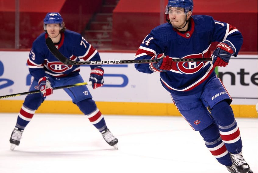 Montreal Canadiens centre Nick Suzuki, right, reacts to a change in play as Montreal Canadiens right wing Tyler Toffoli looks on during NHL action against the Winnipeg Jets in Montreal on March 4, 2021.