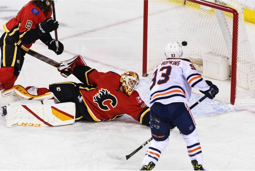 Edmonton Oilers forward Ryan Nugent-Hopkins scores on Flames goalie Jacob Markstrom during the first period of Wednesday night's game at the Scotiabank Saddledome on Wednesday.