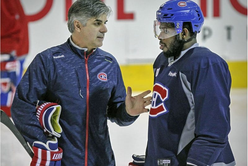 Montreal Canadiens assistant coach J.J. Daigneault has a conversation with defenceman P.K. Subban during practice on April 30, 2015.