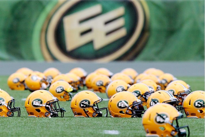 Helmets sit on the field during an Edmonton Football Team practice at Commonwealth Stadium on June 10, 2014.