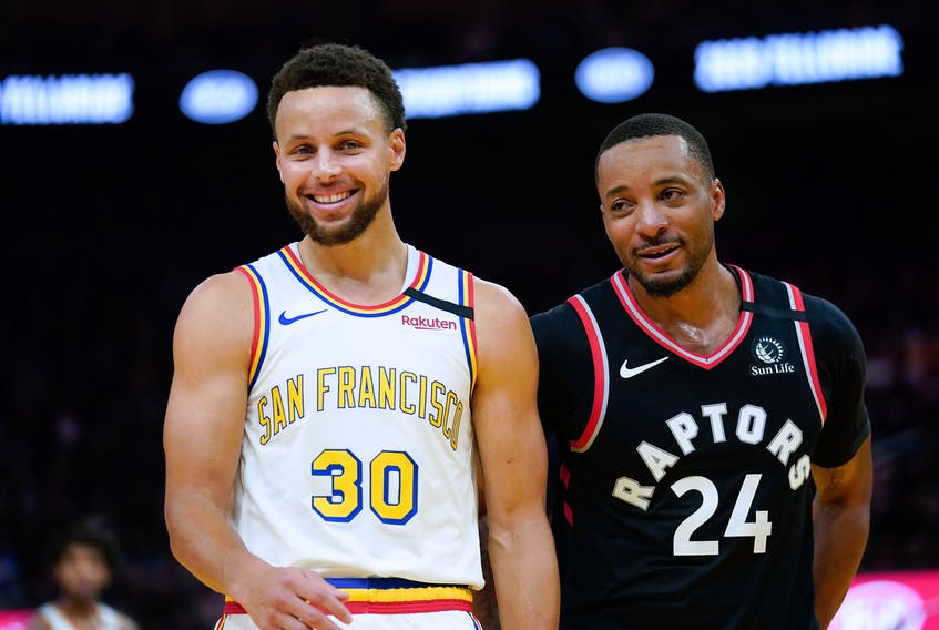 Golden State Warriors guard Stephen Curry and Toronto Raptors guard Norman Powell share a laugh during Thursday's game. (USA TODAY SPORTS)
