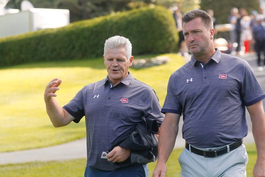 Former Canadiens Chris Nilan, left, and Stéphane Richer were on hand at the Canadiens' annual golf tournament on Sept. 9. Richer says Habs brass does its best to keep alumni away from current players.