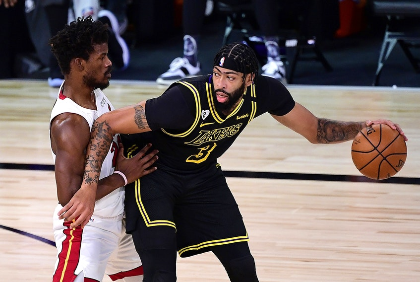L.A. Lakers' Anthony Davis is defended by Miami Heat forward Jimmy Butler.