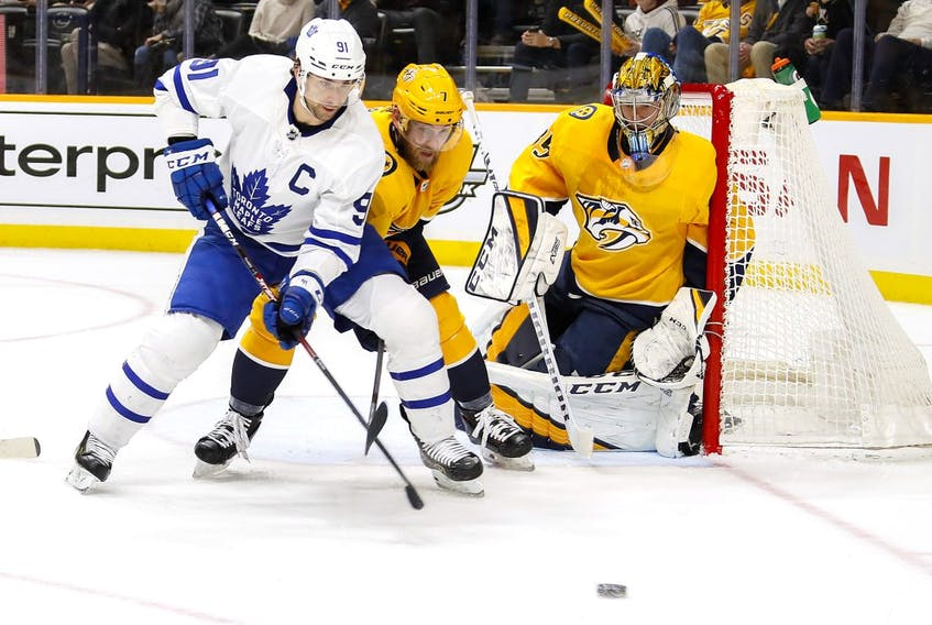 John Tavares #91 of the Toronto Maple Leafs fights Yannick Weber #7 of the Nashville Predators for the puck in front of Predators goalie Pekka Rinne #35 during the second period at Bridgestone Arena on January 27, 2020 in Nashville, Tennessee. (Photo by Frederick Breedon/Getty Images)