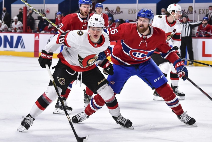 Senators winger Tim Stuetzle tries to hold off Jeff Petry of the Canadiens during first-period action on Tuesday, March 2, 2021.