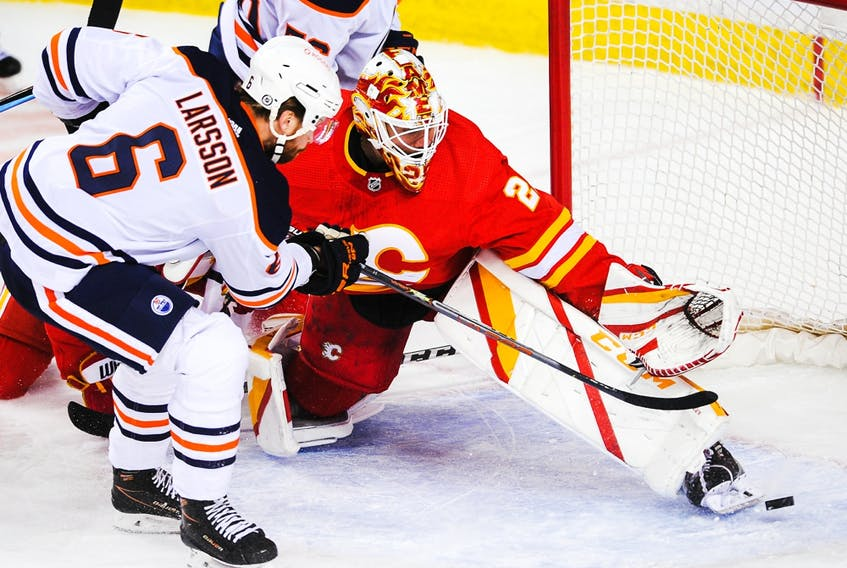 Adam Larsson (6) of the Edmonton Oilers scores against goaltender Jacob Markstrom (25) of the Calgary Flames at Scotiabank Saddledome on March 15, 2021, in Calgary.