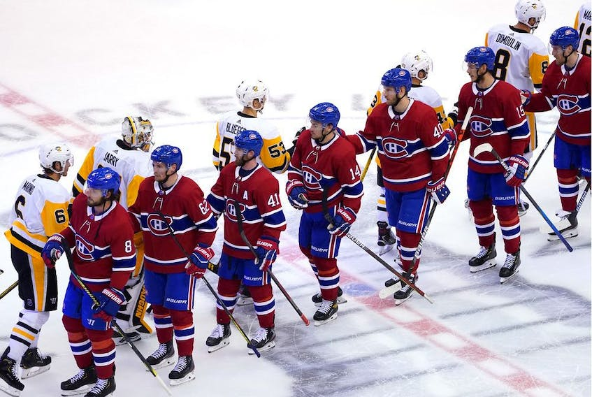 The Canadiens and the Pittsburgh Penguins pump elbows after the series finale in Game Four of the Eastern Conference Qualification Round prior to the 2020 NHL Stanley Cup Playoffs at Scotiabank Arena on Friday, Aug. 7, 2020, in Toronto.