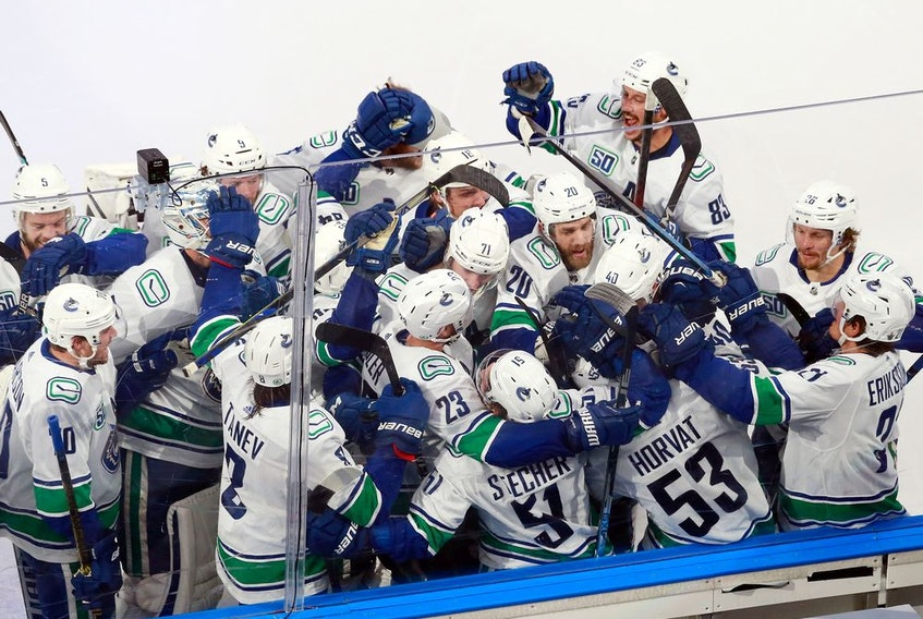 The Vancouver Canucks celebrate their Game 2 overtime victory, courtesy of a Bo Horvat goal, against the St. Louis Blues in their NHL Western Conference first-round playoff series at Rogers Place in Edmonton on Aug. 14, 2020.