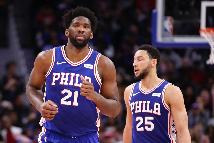 Joel Embiid (left) and Ben Simmons have not fit well together for the Philadelphia 76ers. (GETTY IMAGES)
