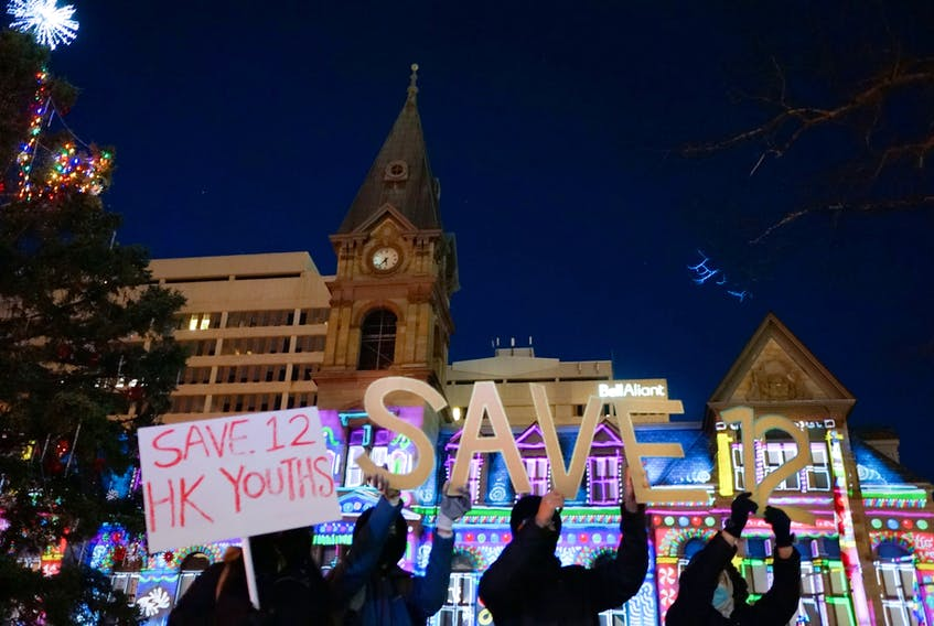 Halifax-Hong Kong Link activists draw attention to the cause of freedom at Grand Parade in Halifax in December 2020.