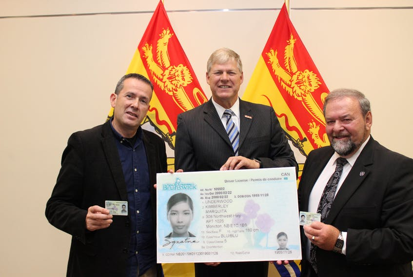 The provincial government has announced new driver's licences and photo identification cards that include enhanced features to guard against forgery. From left to right: Environment and Local Government Minister Serge Rousselle; deputy premier Stephen Horsman; and Justice and Public Safety Minister Denis Landry.