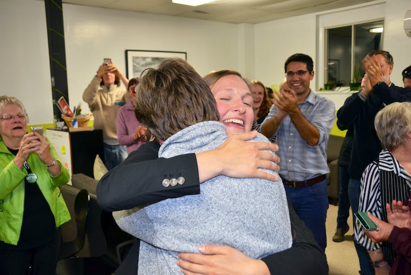 Memramcook-Tantramar Green Party candidate Megan Mitton embraces her campaign manager Sabine Dietz after learning she was elected as the riding's new MLA.