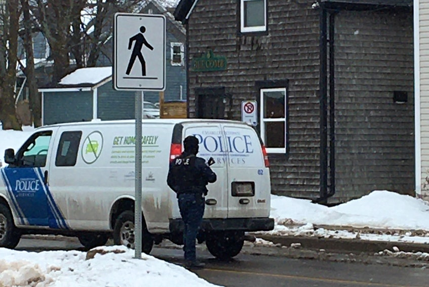 An armed police officer stands outside the Inn on the Harbour on Water Street in Charlottetown on Feb. 25. Rafe Wright/Special to The Guardian
