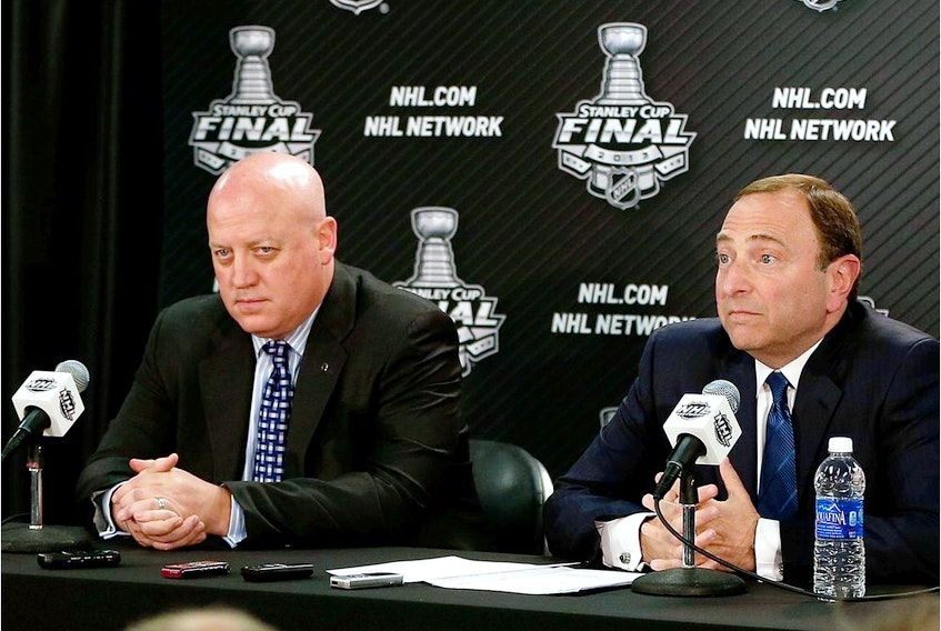 FILE PHOTO: NHL deputy commissioner Bill Daly (left) and NHL Commissioner Gary Bettman answers questions from the media at a press conference.