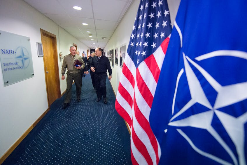 Marine Corps Gen. Joe Dunford, then chairman of the Joint Chiefs of Staff, walks to meet with Kay Bailey Hutchison, then U.S. Ambassador to NATO, ahead of the 178th Military Committee in Chiefs of Defense Session at NATO headquarters, in Brussels, Belgium on Jan. 15th, 2018. - U.S. Department of Defence / Navy Petty Officer 1st Class Dominique A. Pineiro