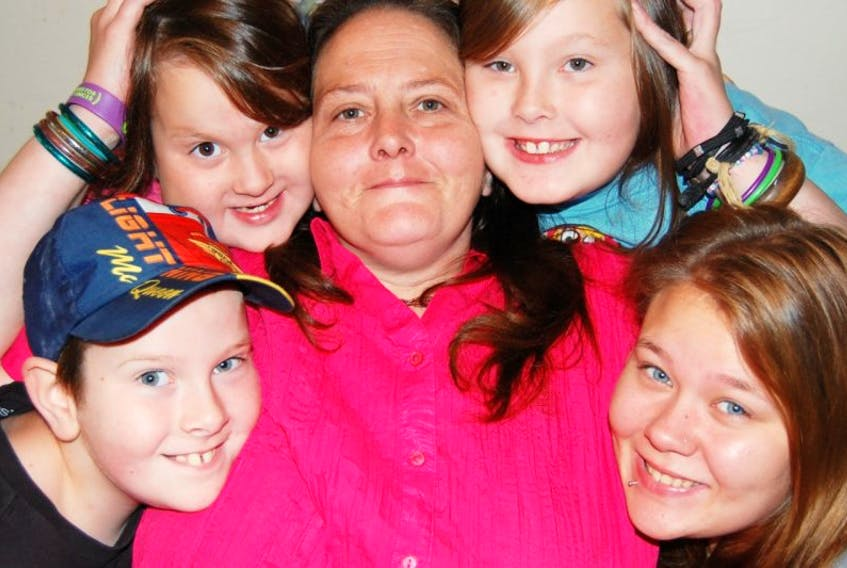 Cathy McClintick with her four children, Tamara (from top left), Summer, Draven and Cherokee.