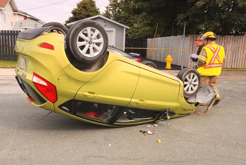 One woman was injured after her car overturned during a two-vehicle crash in the Gould's Saturday afternoon. Keith Gosse/The Telegram
