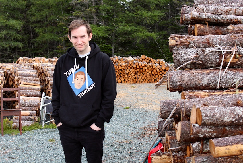 Bryan Tobin is the host of Tobin Tonight, a podcast he produces from his home in Witless Bay. – Andrew Waterman/The Telegram