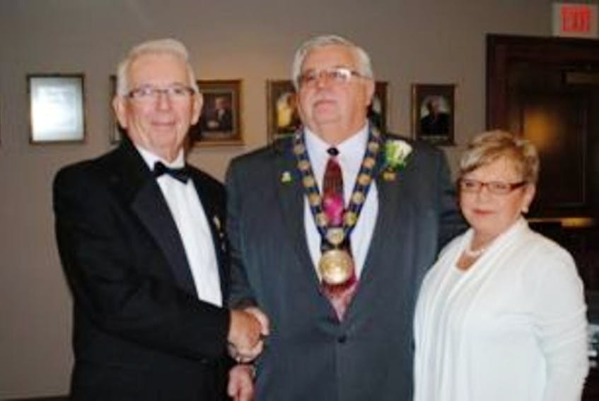 ['Lt.-Gov. Frank Lewis is greeted by Summerside Mayor Basil and Gail Stewart during the levee in 2012']