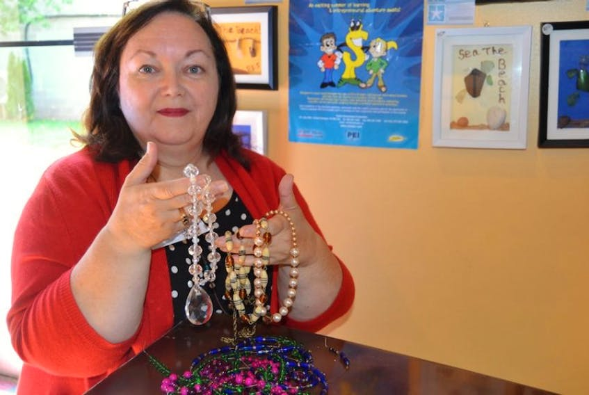 Pam Stevenson holds two of her newest creations. The jewelry artist's work can be seen at Pottery by the Sea in North Rustico, Veseys in York and the Downtown Farmers Market in Charlottetown, located on Queen Street, on Sundays.