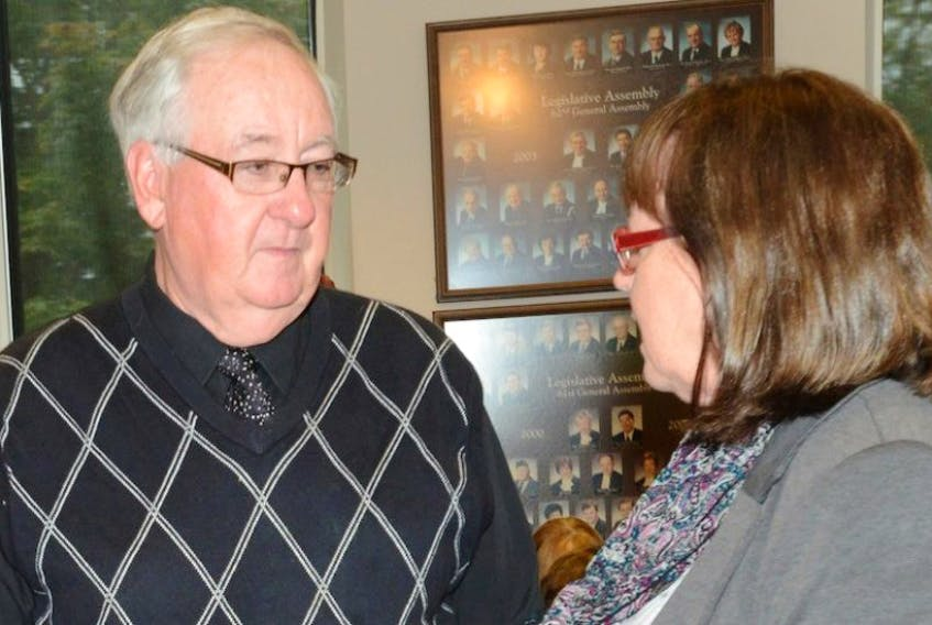 Dr. Des Colohan speaks with Morell-St. Peters MLA Olive Crane outside the legislative standing committee on health in Charlottetown Wednesday, Oct. 1.
