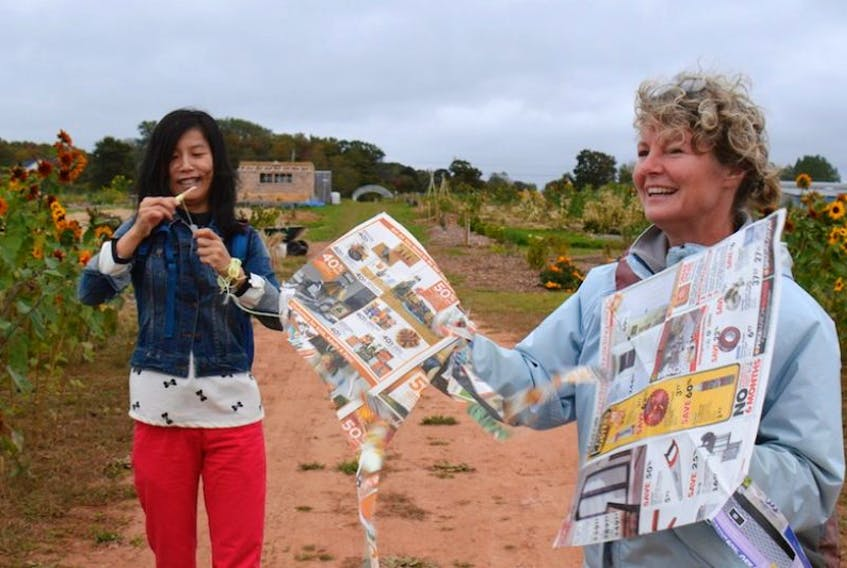 Sammy Deng, who is a graduate student at UPEI, used skills honed in her home city of Beijing in China to craft these newspaper kites with Friends of the Farm member Laura Lee Howard.