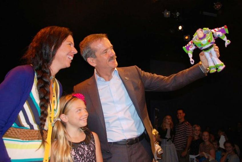 Effie Able and her daughter Ceciley are all smiles as former Canadian astronaut Chris Hadfield has a little fun in Charlottetown with fellow space traveller Buzz Lightyear.