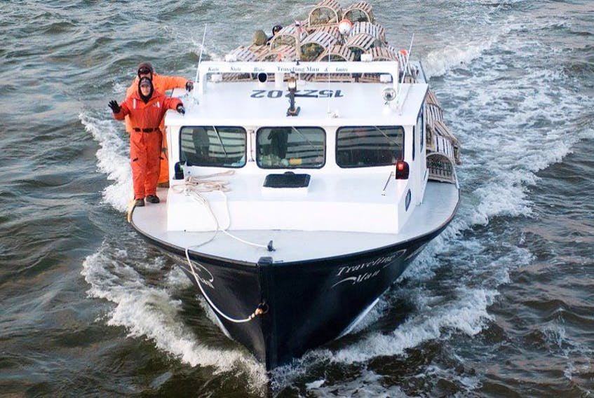 <p>Lobster fishermen wave to people watching the boats leave Covehead Hartbour, P.E.I at dawn Friday May 8, 2015&nbsp; for the opening of the season that was delayed eight days due toi ice conditions in the Gulf of St. Lawrence.</p>