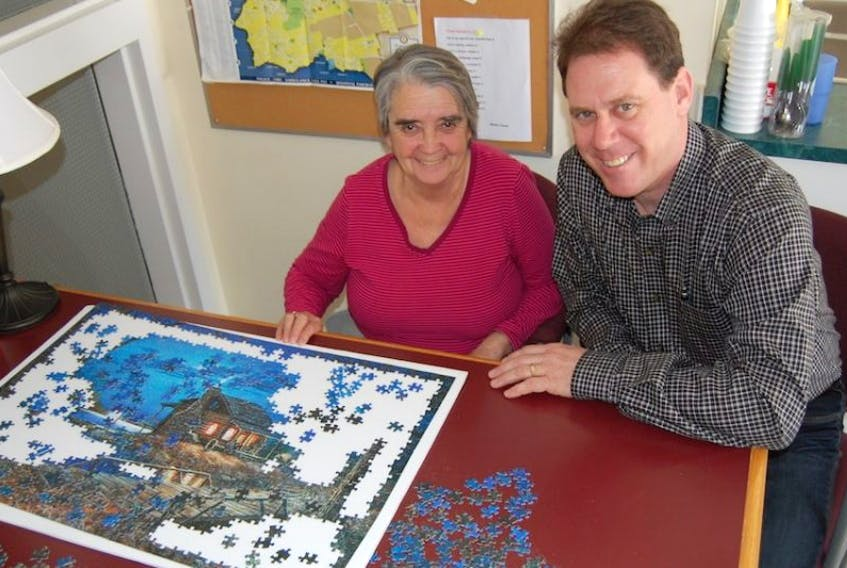 James Aylward takes time to survey Stratford resident Shirley Cleveland's puzzle progress while on the campaign trail. Aylward is one of three contenders for leadership of the PC party of P.E.I.
