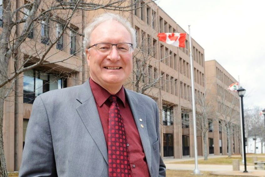 Premier Wade MacLauchlan outside the provincial government buildings in Charlottetown Tuesday, a day after leading the Liberals to a third straight majority government.