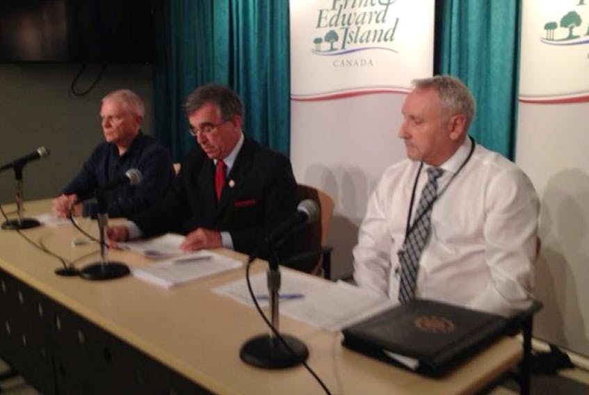 From left, Craig Mackie, P.E.I. Newcomers to Canada, P.E.I. Immigration Minister Richard Brown and Dan Doran with the Roman Catholic diocese, speak about welcoming Syrian refugees to the Island.