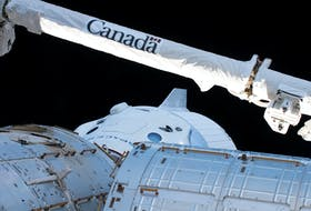 The Canadarm2 robotic arm, built by Canadian technology company MDA, is seen over the uncrewed SpaceX Crew Dragon spacecraft as it makes the first Commercial Crew vehicle to visit the International Space Station March 4, 2019. - NASA / Handout via Reuters