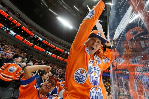 Fans celebrate Edmonton Oilers forward Leon Draisaitl's game-winning goal over the New York Rangers during NHL action at Rogers Place in Edmonton on March 11, 2019.
