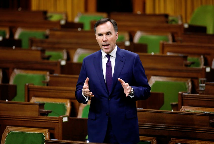 Federal Finance Minister Bill Morneau speaks in the House of Commons as MPs convene to give the government power to inject billions of dollars in emergency cash to help individuals and businesses through the economic crunch caused by the novel coronavirus outbreak, on Parliament Hill in Ottawa, on Wednesday, March 25, 2020. - Blair Gable / Reuters