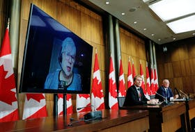 Federal Fisheries Minister Bernadette Jordan (on screen), Indigenous Services Minister Marc Miller and Public Safety Minister Bill Blair take part in a news conference about the dispute between Nova Scotia commercial and Mi'kmaw lobster fishers, on Parliament Hill in Ottawa on Monday, Oct. 19, 2020.