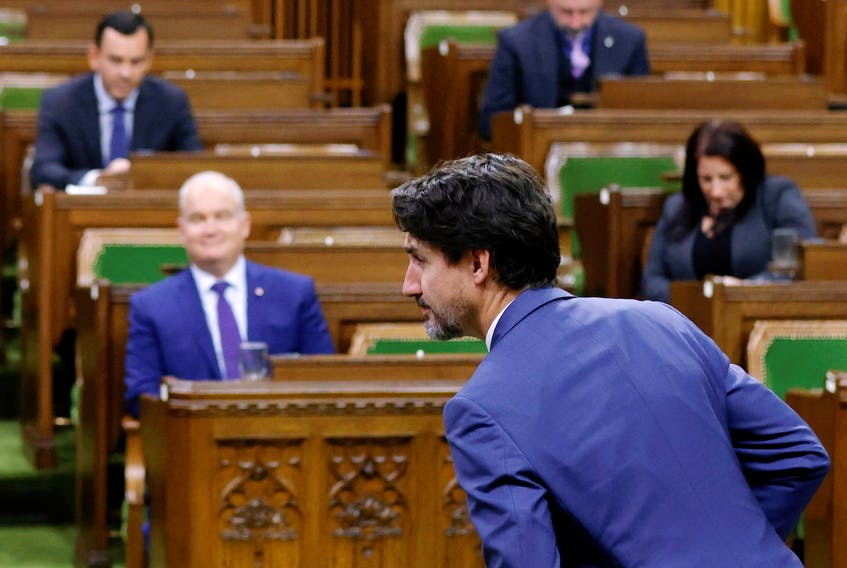 Prime Minister Justin Trudeau rises to vote on a confidence motion against his government in the House of Commons on Parliament Hill in Ottawa, on Oct. 21, 2020.