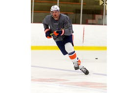 Suffolk's Ross Johnston skates at MacLauchlan Arena in June in preparation for the NHL's return to play.