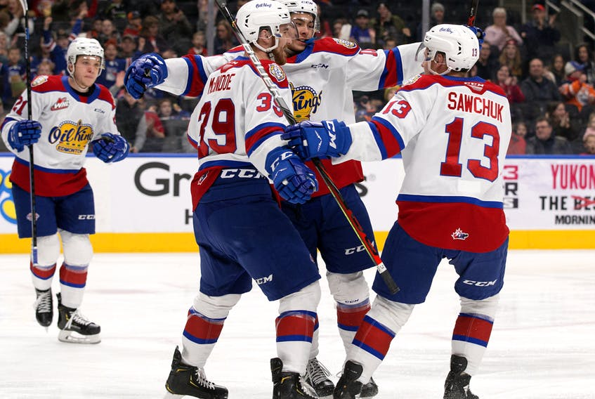 The Edmonton Oil Kings' Dylan Guenther (11) celebrates his goal with Ethan McIndoe (39) and Riley Sawchuk (13) against the Saskatoon Blades at Rogers Place on Jan. 5, 2020.