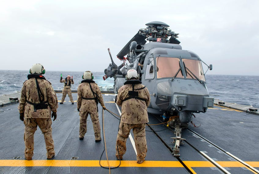 A CH-148 Cyclone helicopter is guided into position aboard HMCS Fredericton during Operation Reassurance on Jan. 22, 2020. - Cpl. Simon Arcand / Canadian Forces