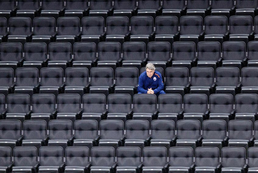 Edmonton Oilers head coach Dave Tippett watches a scrimmage from the empty stands of Rogers Place on July 13, 2020.