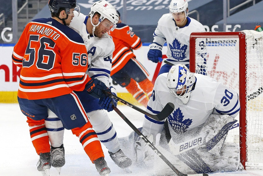 Toronto Maple Leafs goaltender Michael Hutchinson (30) makes a save against Edmonton Oilers forward Kailer Yamamoto (56) during the first period at Rogers Place.