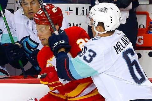 Calgary Flames Trevor Lewis battles Seattle Kraken's Jacob Melanson in   pre-season NHL action at the Scotiabank Saddledome in Calgary on Wednesday, September 29, 2021.  Darren Makowichuk