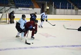 Charlottetown Islanders defenceman Noah Laaouan, left, and forward Keiran Gallant of Covehead battle for the puck during a recent practice. The Islanders host the Saint John Sea Dogs in their 2021-22 Quebec Major Junior Hockey League home opener at Eastlink Centre on Oct. 2 at 7 p.m.